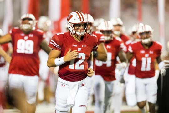 Aug 31, 2018; Madison, WI, USA; Wisconsin Badgers quarterback Alex Hornibrook (12) runs onto the field prior to the game against the Western Kentucky Hilltoppers at Camp Randall Stadium. Mandatory Credit: Jeff Hanisch-USA TODAY Sports