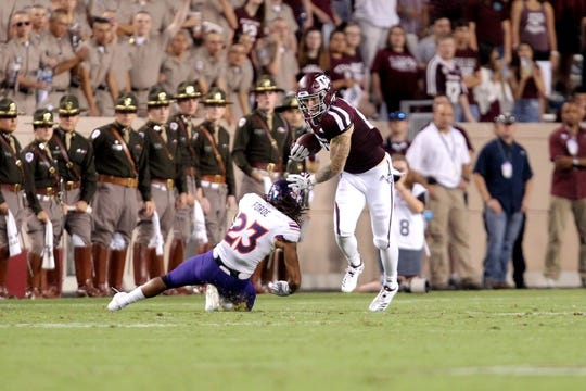 Aug 30, 2018; College Station, TX, USA; Texas A&M Aggies tight end Jace Sternberger (81) runs past Northwestern State Demons safety Nicholas Forde (23) after a pass reception during the first quarter at Kyle Field. Mandatory Credit: Erik Williams-USA TODAY Sports