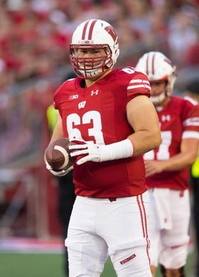 Aug 31, 2018; Madison, WI, USA; Wisconsin Badgers offensive lineman Michael Deiter (63) during warmups prior to the game against the Western Kentucky Hilltoppers at Camp Randall Stadium. Mandatory Credit: Jeff Hanisch-USA TODAY Sports