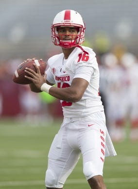 Sep 8, 2018; Madison, WI, USA; New Mexico Lobos quarterback Tevaka Tuioti (16) throws a pass during warmups prior to a game against the Wisconsin Badgers at Camp Randall Stadium. Mandatory Credit: Jeff Hanisch-USA TODAY Sports