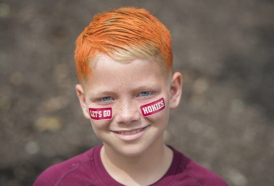 Sep 8, 2018; Blacksburg, VA, USA; Virginia Tech Hokies fan Michael Durbin colors his hair and applied Hokies stickers to his cheeks prior to a game against the William & Mary Tribe at Lane Stadium. Mandatory Credit: Lee Luther Jr.-USA TODAY Sports