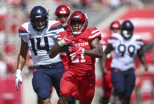 Sep 8, 2018; Houston, TX, USA; Houston Cougars running back Patrick Carr (21) runs with the ball during the first quarter against the Arizona Wildcats at TDECU Stadium. Mandatory Credit: Troy Taormina-USA TODAY Sports