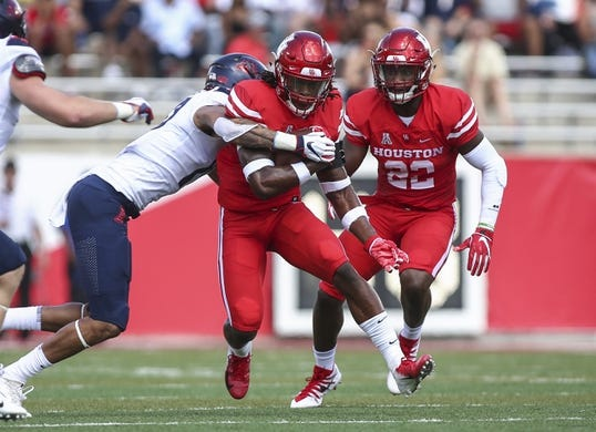 Sep 8, 2018; Houston, TX, USA; Houston Cougars defensive back Garrett Davis (1) runs with the ball after making an interception during the first quarter against the Arizona Wildcats at TDECU Stadium. Mandatory Credit: Troy Taormina-USA TODAY Sports