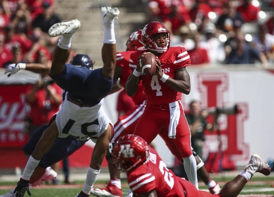 Sep 8, 2018; Houston, TX, USA; Arizona Wildcats safety Xavier Bell (37) flips as Houston Cougars quarterback D'Eriq King (4) attempts a pass during the first quarter at TDECU Stadium. Mandatory Credit: Troy Taormina-USA TODAY Sports