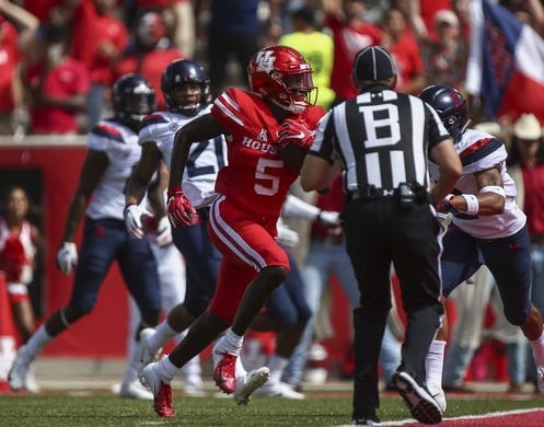 Sep 8, 2018; Houston, TX, USA; Houston Cougars wide receiver Marquez Stevenson (5) runs with the ball for a touchdown during the first quarter against the Arizona Wildcats at TDECU Stadium. Mandatory Credit: Troy Taormina-USA TODAY Sports