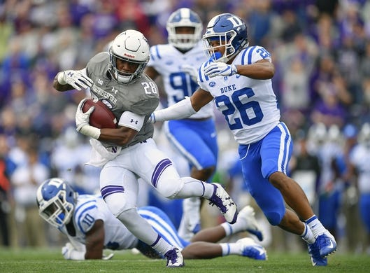 Sep 8, 2018; Evanston, IL, USA; Northwestern Wildcats running back Jeremy Larkin (28) runs with the ball in the first half against Duke Blue Devils safety Michael Carter II (26) at Ryan Field. Mandatory Credit: Quinn Harris-USA TODAY Sports