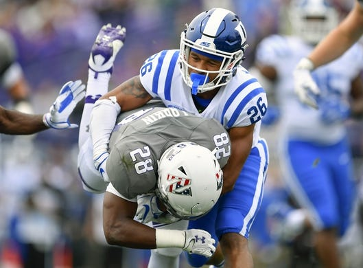 Sep 8, 2018; Evanston, IL, USA; Duke Blue Devils safety Michael Carter II (26) tackles Northwestern Wildcats running back Jeremy Larkin (28) in the first half at Ryan Field. Mandatory Credit: Quinn Harris-USA TODAY Sports