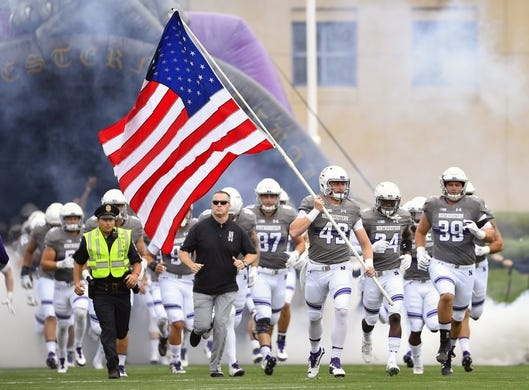 Sep 8, 2018; Evanston, IL, USA; Northwestern Wildcats head coach Pat Fitzgerald and team enters the field before the game against the Duke Blue Devils at Ryan Field. Mandatory Credit: Quinn Harris-USA TODAY Sports