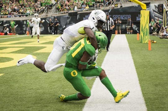 Sep 8, 2018; Eugene, OR, USA; Oregon Ducks wide receiver Jaylon Redd (30) catches a touchdown pass against Portland State Vikings safety Romeo Gunt (1) during the first half at Autzen Stadium. Mandatory Credit: Troy Wayrynen-USA TODAY Sports