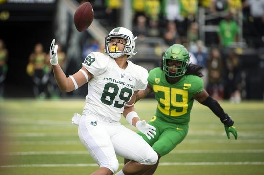 Sep 8, 2018; Eugene, OR, USA; Portland State Vikings tight end Charlie Taumoepeau (89) catches a pass as he is defended by Oregon Ducks linebacker Kaulana Apelu (39) during the first half at Autzen Stadium. Mandatory Credit: Troy Wayrynen-USA TODAY Sports