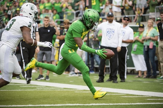 Sep 8, 2018; Eugene, OR, USA; Oregon Ducks wide receiver Tabari Hines (17) scores a touchdown as he is pursued by Portland State Vikings safety Sam Inos (3) during the first half at Autzen Stadium. Mandatory Credit: Troy Wayrynen-USA TODAY Sports