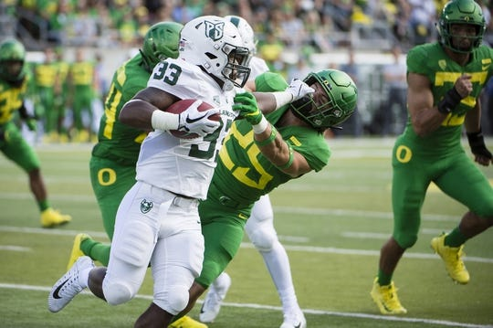 Sep 8, 2018; Eugene, OR, USA; Portland State Vikings running back Darian Green (33) stiff arms Oregon Ducks safety Brady Breeze (25) during the first half at Autzen Stadium. Mandatory Credit: Troy Wayrynen-USA TODAY Sports