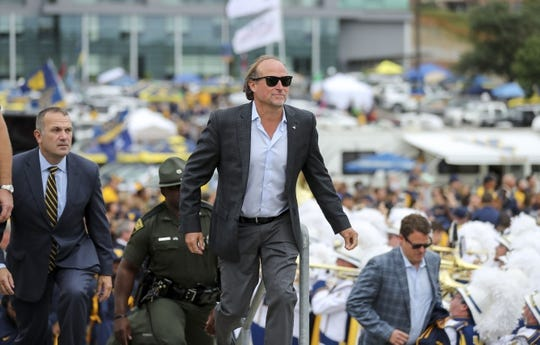 Sep 8, 2018; Morgantown, WV, USA; West Virginia Mountaineers head coach Dana Holgorsen arrives at the stadium prior to a game against the Youngstown State Penguins at Mountaineer Field at Milan Puskar Stadium. Mandatory Credit: Ben Queen-USA TODAY Sports