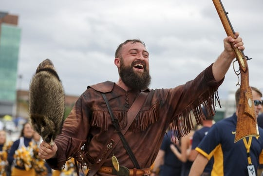 Sep 8, 2018; Morgantown, WV, USA; The West Virginia Mountaineers mascot leads the team through fans as they arrive to the field before a game against the Youngstown State Penguins at Mountaineer Field at Milan Puskar Stadium. Mandatory Credit: Ben Queen-USA TODAY Sports