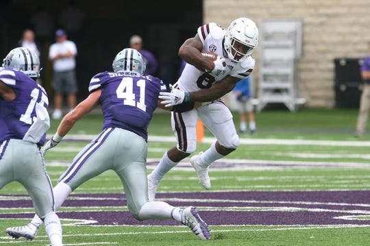 Sep 8, 2018; Manhattan, KS, USA; Mississippi State Bulldogs running back Kylin Hill (8) breaks away from Kansas State Wildcats linebacker Sam Sizelove (41) during the fourth quarter at Bill Snyder Family Stadium. The Bulldogs won 31-10. Mandatory Credit: Scott Sewell-USA TODAY Sports
