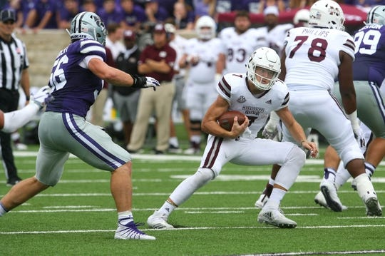 Sep 8, 2018; Manhattan, KS, USA; Mississippi State Bulldogs quarterback Nick Fitzgerald (7) carries the ball against Kansas State Wildcats defensive end Wyatt Hubert (56) during the fourth quarter at Bill Snyder Family Stadium. The Bulldogs won 31-10. Mandatory Credit: Scott Sewell-USA TODAY Sports