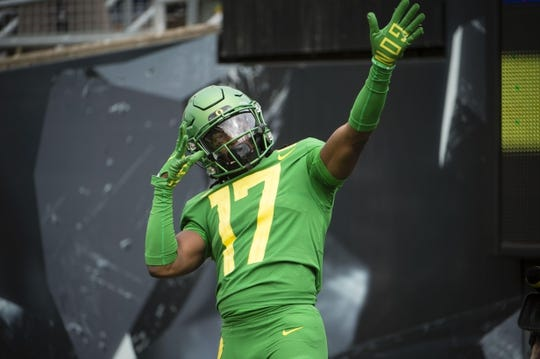 Sep 8, 2018; Eugene, OR, USA; Oregon Ducks wide receiver Tabari Hines (17) celebrates after catching a touchdown pass against the Portland State Vikings at Autzen Stadium. Mandatory Credit: Troy Wayrynen-USA TODAY Sports