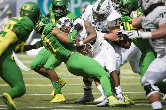 Sep 8, 2018; Eugene, OR, USA; Oregon Ducks linebacker Jalen Jelks (97) sacks Portland State Vikings quarterback Jalani Eason (10) during the first half at Autzen Stadium. Mandatory Credit: Troy Wayrynen-USA TODAY Sports