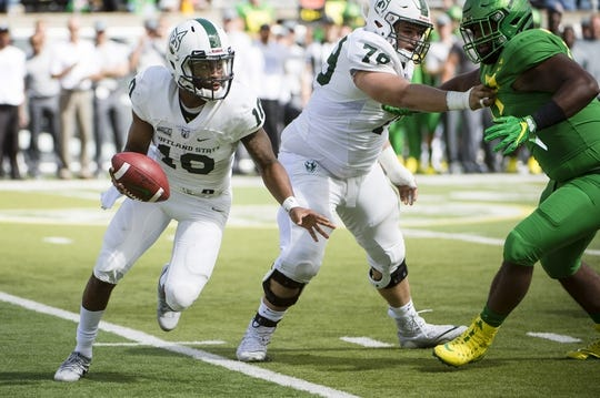 Sep 8, 2018; Eugene, OR, USA; Portland State Vikings quarterback Jalani Eason (10) breaks away from an Oregon Ducks defender during the first half at Autzen Stadium. Mandatory Credit: Troy Wayrynen-USA TODAY Sports