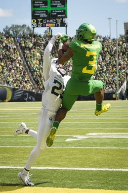 Sep 8, 2018; Eugene, OR, USA; Oregon Ducks wide receiver Johnny Johnson III (3) catches a touchdown pass over Portland State Vikings cornerback Montre Brown (23) during the first half at Autzen Stadium. Mandatory Credit: Troy Wayrynen-USA TODAY Sports