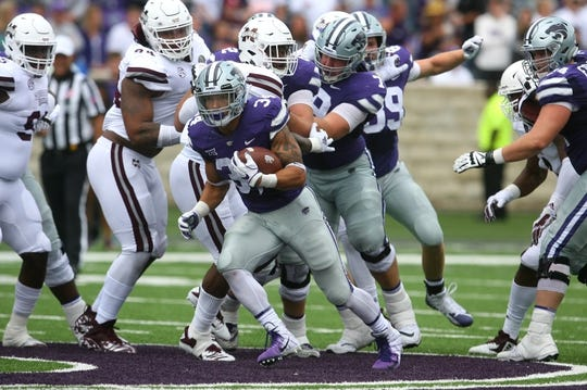 Sep 8, 2018; Manhattan, KS, USA; Kansas State Wildcats running back Alex Barnes (34) runs the ball during the fourth quarter against the Mississippi State Bulldogs at Bill Snyder Family Stadium. Mandatory Credit: Scott Sewell-USA TODAY Sports