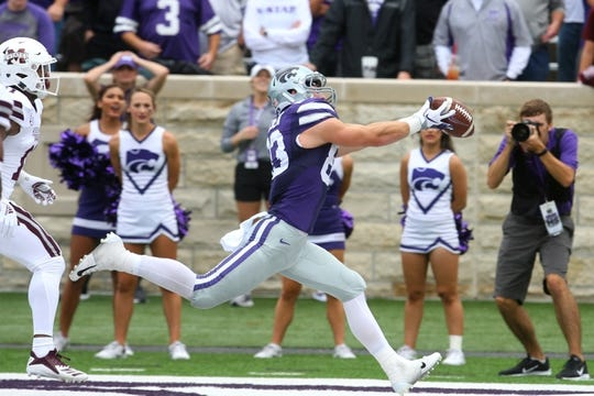 Sep 8, 2018; Manhattan, KS, USA; Kansas State Wildcats wide receiver Dalton Schoen (83) makes a touchdown catch against Mississippi State Bulldogs safety Jaquarius Landrews (11) during the third quarter at Bill Snyder Family Stadium. Mandatory Credit: Scott Sewell-USA TODAY Sports