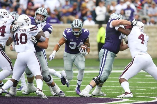 Sep 8, 2018; Manhattan, KS, USA; Kansas State Wildcats running back Alex Barnes (34) carries the ball during the second quarter against the Mississippi State Bulldogs at Bill Snyder Family Stadium. The Bulldogs won, 31-10. Mandatory Credit: Scott Sewell-USA TODAY Sports