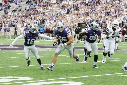 Sep 8, 2018; Manhattan, KS, USA; Kansas State Wildcats defensive end Wyatt Hubert (56) looks for room to run after intercepting a pass during the fourth third quarter against the Mississippi State Bulldogs at Bill Snyder Family Stadium. The Bulldogs won, 31-10. Mandatory Credit: Scott Sewell-USA TODAY Sports