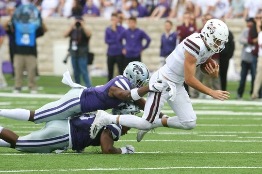 Sep 8, 2018; Manhattan, KS, USA; Mississippi State Bulldogs quarterback Nick Fitzgerald (7) is tackled by Kansas State Wildcats linebacker Da'Quan Patton (5) and defensive back Eli Walker (7) during the fourth quarter at Bill Snyder Family Stadium. The Bulldogs won, 31-10. Mandatory Credit: Scott Sewell-USA TODAY Sports
