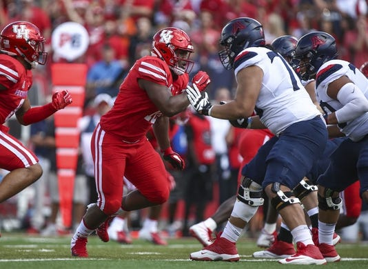 Sep 8, 2018; Houston, TX, USA; Houston Cougars defensive tackle Ed Oliver (10) rushes against the Arizona Wildcats offense at TDECU Stadium. Mandatory Credit: Troy Taormina-USA TODAY Sports