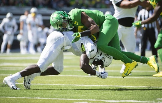 Sep 8, 2018; Eugene, OR, USA; Portland State Vikings safety Romeo Gunt (1) tackles Oregon Ducks running back Taj Griffin (5) during the second half at Autzen Stadium. The Ducks won 62-14. Mandatory Credit: Troy Wayrynen-USA TODAY Sports