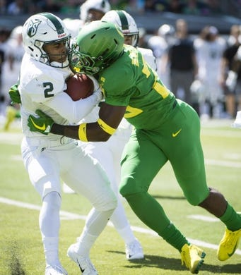 Sep 8, 2018; Eugene, OR, USA; Portland State Vikings wide receiver Antwone Williams (2) is tackled by Oregon Ducks linebacker Adrian Jackson (29) during the second half at Autzen Stadium. The Ducks won 62-14. Mandatory Credit: Troy Wayrynen-USA TODAY Sports