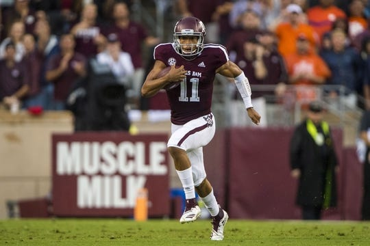 Sep 8, 2018; College Station, TX, USA; Texas A&M Aggies quarterback Kellen Mond (11) runs for a first down against the Clemson Tigers during the first quarter at Kyle Field. Mandatory Credit: Jerome Miron-USA TODAY Sports