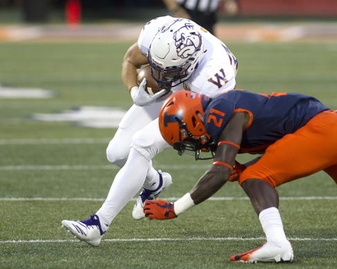 Sep 8, 2018; Champaign, IL, USA; Illinois Fighting Illini defensive back Jartavius Martin (21) tackles Western Illinois Leathernecks running back Steve McShane (5) during the first quarter at Memorial Stadium. Mandatory Credit: Mike Granse-USA TODAY Sports