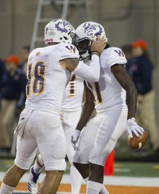 Sep 8, 2018; Champaign, IL, USA; Western Illinois Leathernecks quarterback Sean McGuire (18) celebrates a touchdown with wide receiver George Wahee (11) during the first quarter against the Illinois Fighting Illini at Memorial Stadium. Mandatory Credit: Mike Granse-USA TODAY Sports