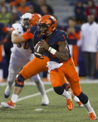 Sep 8, 2018; Champaign, IL, USA; Illinois Fighting Illini quarterback AJ Bush (1) carries the ball during the first quarter against the Western Illinois Leathernecks at Memorial Stadium. Mandatory Credit: Mike Granse-USA TODAY Sports