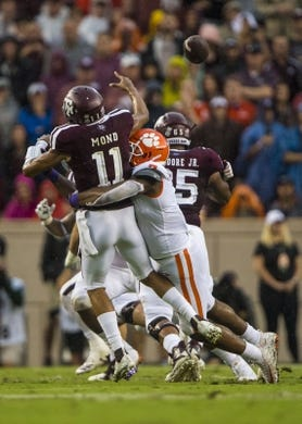 Sep 8, 2018; College Station, TX, USA; Texas A&M Aggies quarterback Kellen Mond (11) is hit by Clemson Tigers defensive end Austin Bryant (7) during the first quarter at Kyle Field. Mandatory Credit: Jerome Miron-USA TODAY Sports