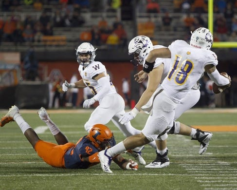 Sep 8, 2018; Champaign, IL, USA; Illinois Fighting Illini defensive lineman Isaiah Gay (92) sacks Western Illinois Leathernecks quarterback Sean McGuire (18) during the second quarter at Memorial Stadium. Mandatory Credit: Mike Granse-USA TODAY Sports