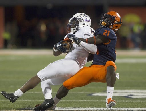 Sep 8, 2018; Champaign, IL, USA; Illinois Fighting Illini defensive back Jartavius Martin (21) tackles Western Illinois Leathernecks running back Steve McShane (5) during the second quarter at Memorial Stadium. Mandatory Credit: Mike Granse-USA TODAY Sports