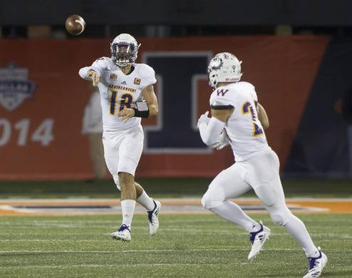 Sep 8, 2018; Champaign, IL, USA; Western Illinois Leathernecks quarterback Sean McGuire (18) completes a pass to Western Illinois Leathernecks running back Clint Ratkovich (25) during the first quarter against the Illinois Fighting Illini at Memorial Stadium. Mandatory Credit: Mike Granse-USA TODAY Sports