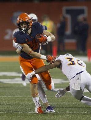 Sep 8, 2018; Champaign, IL, USA; Illinois Fighting Illini running back Mike Epstein (26) is tackled by Western Illinois Leathernecks defensive back Justin Fitzpatrick (30) during the second quarter at Memorial Stadium. Mandatory Credit: Mike Granse-USA TODAY Sports