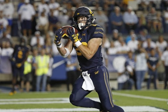 Sep 8, 2018; Provo, UT, USA; California Golden Bears running back Patrick Laird (28) catches a first quarter touchdown against the Brigham Young Cougars at LaVell Edwards Stadium. Mandatory Credit: Jeff Swinger-USA TODAY Sports