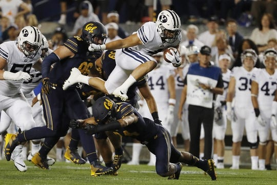 Sep 8, 2018; Provo, UT, USA; Brigham Young Cougars running back Lopini Katoa (4) leaps over California Golden Bears cornerback Camryn Bynum (24) in the first quarter at LaVell Edwards Stadium. Mandatory Credit: Jeff Swinger-USA TODAY Sports