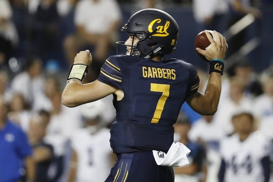 Sep 8, 2018; Provo, UT, USA; California Golden Bears quarterback Chase Garbers (7) drops back to pass against the Brigham Young Cougars at LaVell Edwards Stadium. Mandatory Credit: Jeff Swinger-USA TODAY Sports
