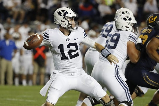 Sep 8, 2018; Provo, UT, USA; Brigham Young Cougars quarterback Tanner Mangum (12) drops back to pass against the California Golden Bears at LaVell Edwards Stadium. Mandatory Credit: Jeff Swinger-USA TODAY Sports