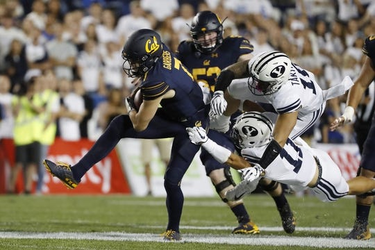 Sep 8, 2018; Provo, UT, USA; California Golden Bears quarterback Chase Garbers (7) runs the ball in the first quarter against the Brigham Young Cougars at LaVell Edwards Stadium. Mandatory Credit: Jeff Swinger-USA TODAY Sports