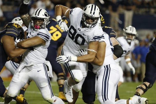 Sep 8, 2018; Provo, UT, USA; Brigham Young Cougars defensive lineman Corbin Kaufusi (90) breaks through the line against the California Golden Bears at LaVell Edwards Stadium. Mandatory Credit: Jeff Swinger-USA TODAY Sports