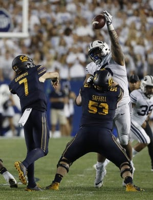 Sep 8, 2018; Provo, UT, USA; Brigham Young Cougars defensive lineman Khyiris Tonga (95) knocks down a pass by California Golden Bears quarterback Chase Garbers (7) in the second quarter at LaVell Edwards Stadium. Mandatory Credit: Jeff Swinger-USA TODAY Sports