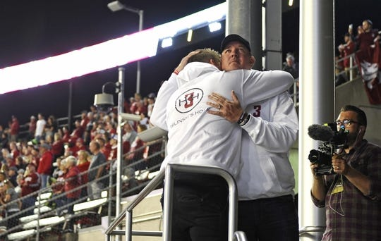 Sep 8, 2018; Pullman, WA, USA; Mark Hilisnki is hugged by a family member after the raising of the Washington State Cougars school flag before their game against the San Jose State Spartans at Martin Stadium. Mandatory Credit: James Snook-USA TODAY Sports