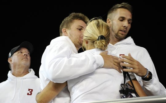 Sep 8, 2018; Pullman, WA, USA; Kym Hilinski is hugged by her son Ryan Hilinski after the raising of the Washington State Cougars school flag before a football game  against the San Jose State Spartans at Martin Stadium. Mandatory Credit: James Snook-USA TODAY Sports